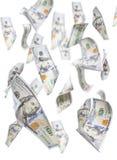 Случайно падающ 100 долларовых банкнот на белизне Стоковые Фото