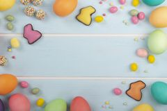 Ð¡hocolate bunnies, Easter dyed chicken eggs, variety of sweets and colorful sprinkles royalty free stock photo