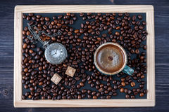 Сoffee and vintage clock on a slate chalk board Royalty Free Stock Photography