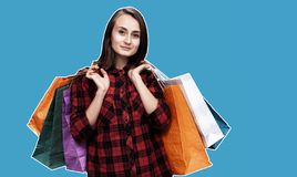 Woman with shoping bags. Ð¡ommerce and shopping season. Happy young woman with shoping bags. Magazine style collage with copy space royalty free stock photography