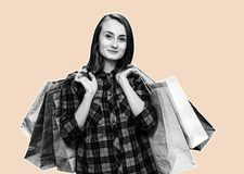 Woman with shoping bags. Ð¡ommerce and shopping season. Happy young woman with shoping bags. Magazine style collage with copy space royalty free stock images