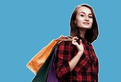 Woman with shoping bags. Ð¡ommerce and shopping season. Happy young woman with shoping bags. Magazine style collage with copy space stock image