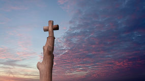 Ð¡ross. Wooden cross is on the background of scarlet sunset royalty free stock image