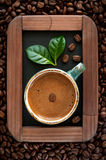 Ð¡up of coffee with green leaves on the menu board Stock Images