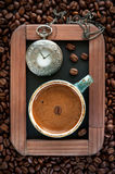Сup of coffee and a vintage pocket watch on a chalkboard Stock Photography