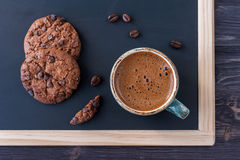 Сup of espresso coffee and chocolate chip cookies Stock Images