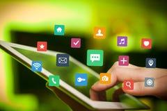 Таблетка пальцев касающая с apps Стоковые Фото