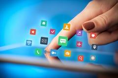 Таблетка пальцев касающая с apps Стоковые Изображения RF
