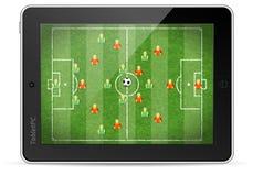 таблетка ПК футбольной игры Стоковые Фотографии RF