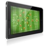 таблетка ПК футбольной игры Стоковая Фотография RF