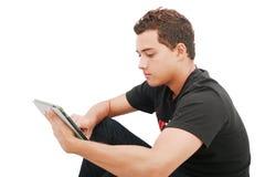 таблетка школы мальчика электронная стоковое фото rf