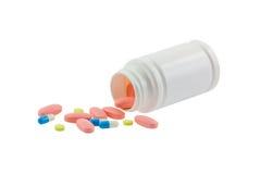 Таблетки и пилюльки изолированные на белизне стоковое фото rf