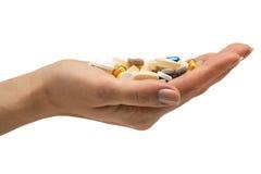 таблетки удерживания руки Стоковые Фото