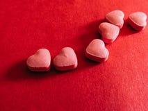 6 таблеток сердца красный цвет поднял Стоковое Изображение