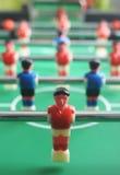 таблица футбола игроков foosball поля Стоковое фото RF