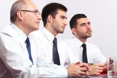 таблица 3 встречи бизнесмена сидя Стоковое Фото