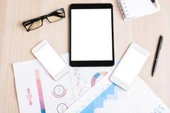 Таблетка и 2 белых smartphones Стоковое Фото
