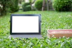 Таблетка на траве Стоковое Фото