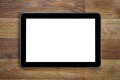 Таблетка с пустым экраном на деревянном столе стоковое фото rf