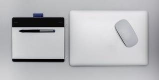 Таблетка цифров графическая и компьтер-книжка стали Стоковые Изображения RF