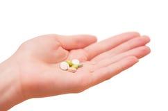 Таблетки в руке Стоковое Изображение RF
