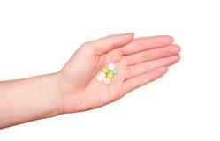 Таблетки в руке Стоковая Фотография