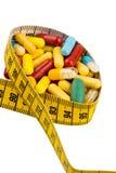 Таблетки и измеряя лента Стоковые Изображения RF
