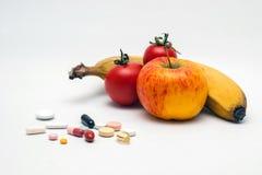 Таблетки, фрукты и овощи Стоковые Изображения