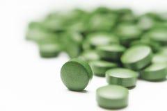 Таблетки хлореллы - зеленые водоросли Стоковая Фотография RF