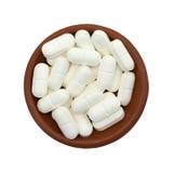 таблетки L-лизина в шаре стоковое фото rf