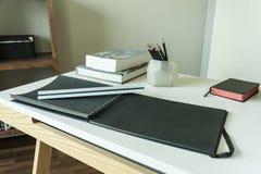 Таблица работы с измеряя инструментами, карандашем и книгой Стоковая Фотография RF