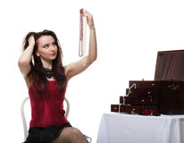 Таец женщины танцовщицы в красной изолированной белизне стула корсета Стоковое фото RF