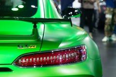 Таиланд - декабрь 2018: Спортивная машина зеленого цвета серии benz AMG Мерседес GTR роскошная в мотор-шоу конец автомобиля вида  стоковое изображение