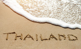 Таиланд написанный на пляже песка около моря - путешествуйте концепция праздника Стоковая Фотография