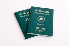 Тайваньские пасспорты на белой предпосылке стоковое фото rf