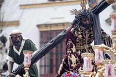 Тайна шага братства надежды Triana, пасхи в Севилье стоковое фото