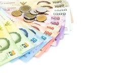 Тайская валюта денег на белой предпосылке Стоковое фото RF