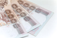 Тайская изолированная валюта в предпосылке и Стоковое фото RF