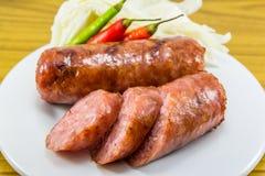 Тайская сосиска с чилями и овощами Стоковая Фотография RF