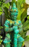 Тайская статуя зеленого цвета Suriyaphob гиганта попечителя буддийского виска Стоковая Фотография RF