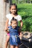 Тайские девушки в саде фасоли Стоковое фото RF