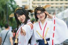 Тайские cosplayers одевают как характеры от шаржа и игры в festa Японии в Бангкоке Стоковые Фото