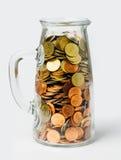 Тайский бат чеканит деньги в стеклянных бутылках стоковое изображение