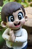 Тайский радушный мальчик куклы штукатурки Стоковая Фотография