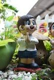 Тайский радушный мальчик куклы штукатурки Стоковые Фотографии RF