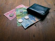 Тайский счет 100, 50 и 20 ванны с тайской монеткой одним Стоковые Изображения