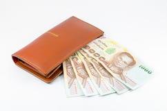 Тайский счет положенный с бумажником Стоковые Изображения RF