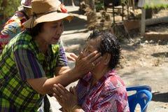 Тайское престарелое празднует фестиваль Songkran или тайский Новый Год Стоковое Изображение RF