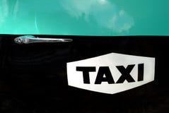 таксомотор логоса Стоковые Фото