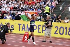 ТАМПЕРЕ, ФИНЛЯНДИЯ, 12-ое июля: Золотая медаль выигрыша HIMA DAS Индии в 400 metrs на чемпионате мира U20 IAAF в Тампере, Финлянд стоковая фотография rf
